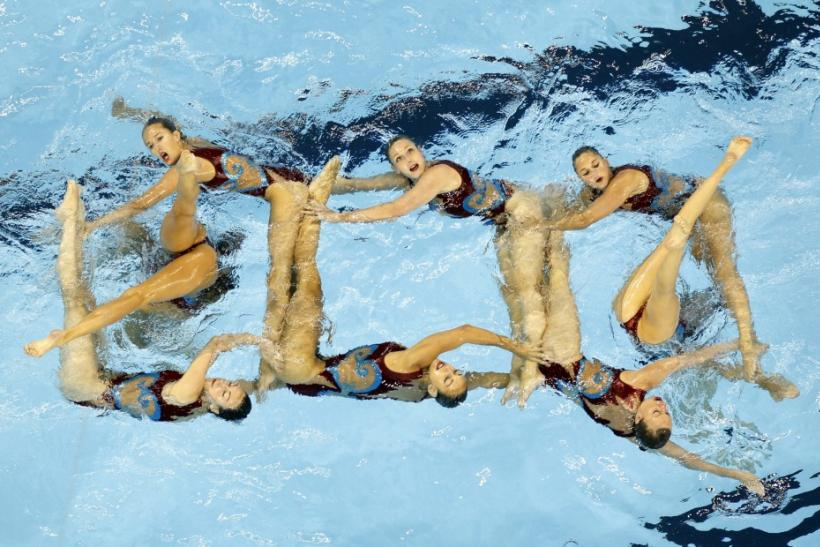 Britain's team performs during the preliminary round of the synchronised swimming free combination routine at the 14th FINA World Championships in Shanghai