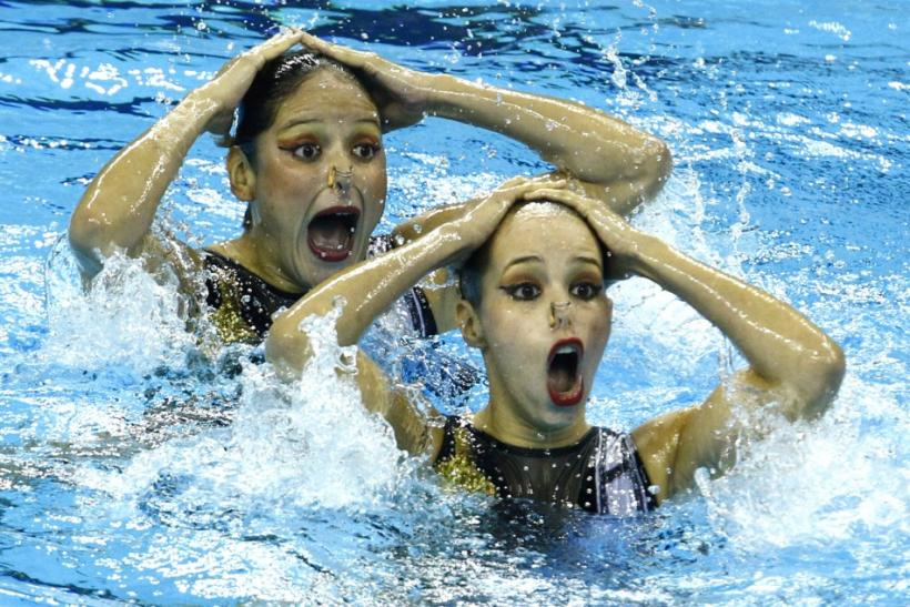 Mexico's Evelyn Guajardo and Isabel Delgado perform in the preliminary round of the synchronised swimming duets free routine at the 14th FINA World Championships in Shanghai