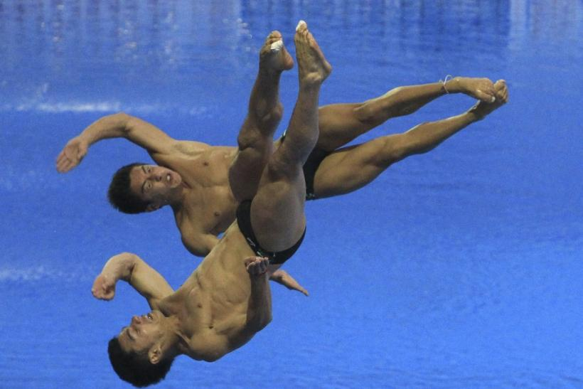 Mexico's Yahel Castillo and Julian Sanchez compete in the men's 3m springboard synchronised diving final at the 14th FINA World Championships in Shanghai July 19, 2011.