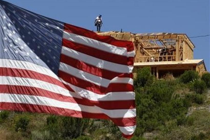 Workers build new homes on a hilltop in Carlsbad, California