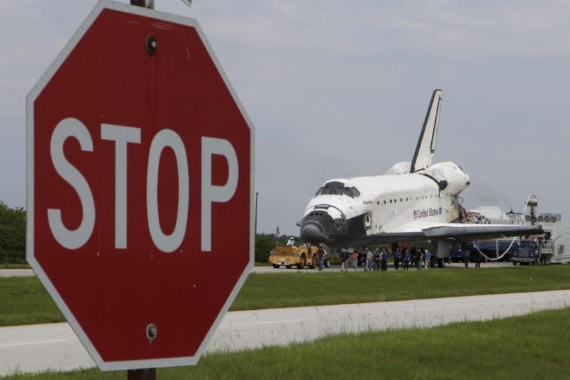 Space shuttle Atlantis is towed to its hangar after landing at the Kennedy Space Center in Cape Canaveral, Florida