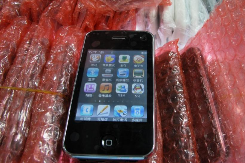 A counterfeit iPhone is shown at a mall selling electronics in the southern Chinese city of Shenzhen in Guangdong province