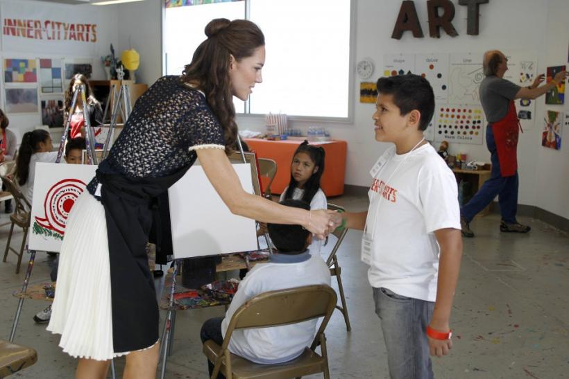 Kate Middleton greets a child during a tour of the Inner City Arts campus in Los Angeles