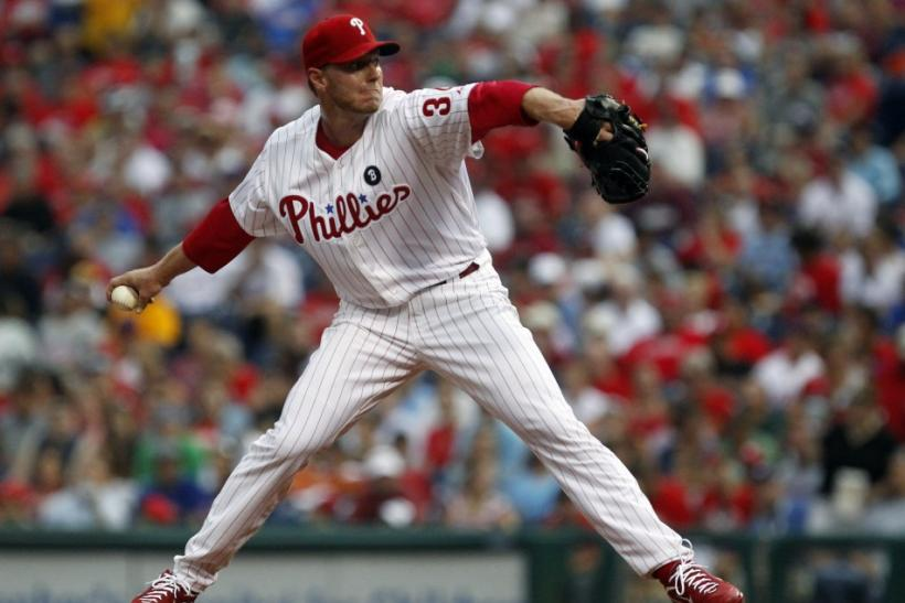 Phillies starting pitcher Halladay delivers a pitch to the Pirates during the first inning of their National league MLB baseball game in Philadelphia
