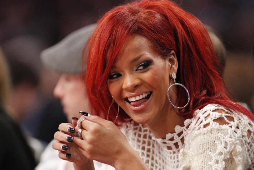 Singer Rihanna sits courtside during the NBA All-Star basketball game in Los Angeles.