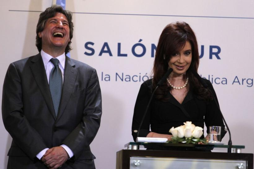 Argentina's Economy Minister Amado Boudou laughs next to President Cristina Fernandez de Kirchner during a news conference in Buenos Aires