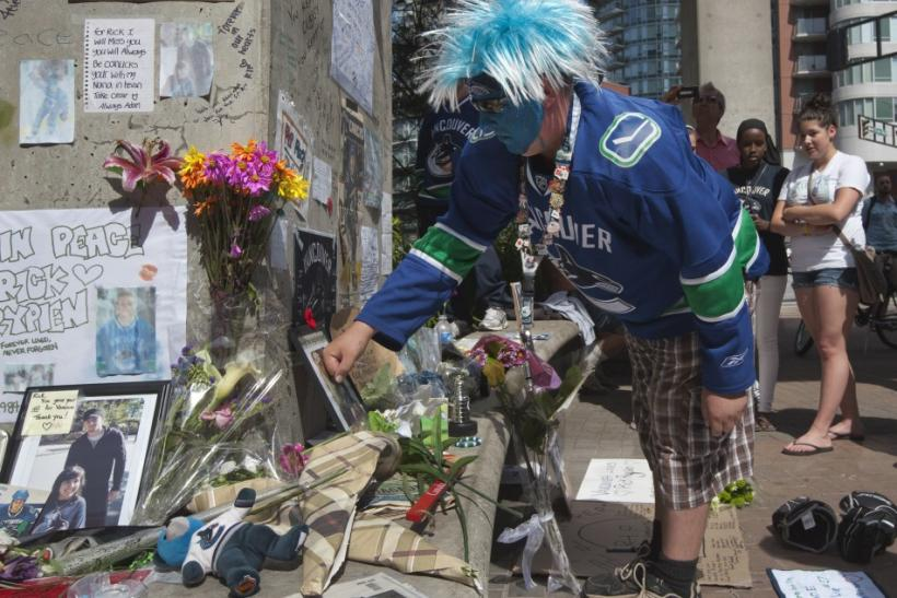 Vancouver Canucks fan pays tribute to former hockey player Rick Rypien during a gathering in Vancouver