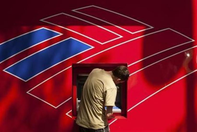 A Bank of America customer uses a Bank of America ATM in Charlotte, North Carolina
