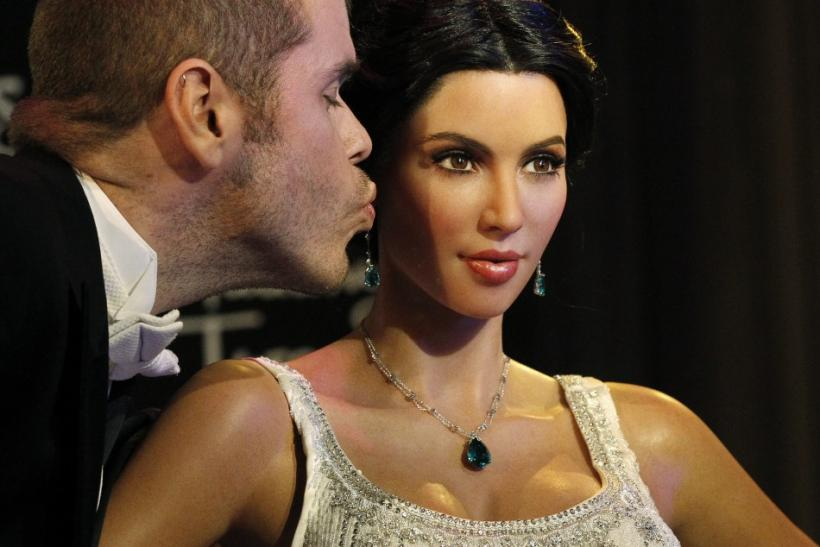 Celebrity blogger Perez Hilton kisses the wax figure of television personality Kim Kardashian after it was unveiled at Madame Tussauds museum in Hollywood, California