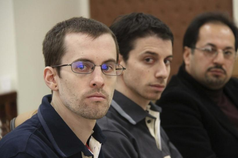 American hikers Shane Bauer (L) and Josh Fattal with their translator at the first session of their trial in Tehran