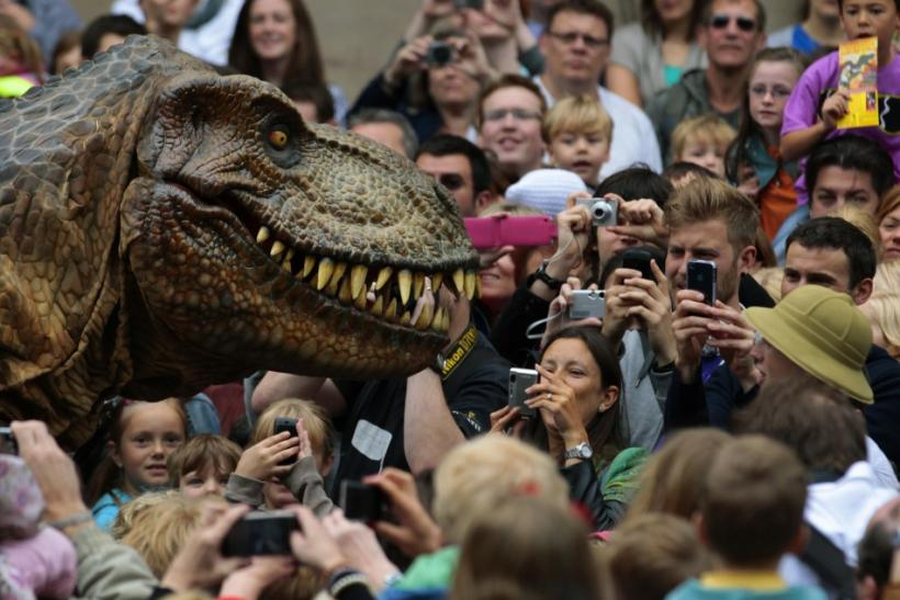 Visitors photograph an animatronic Tyrannosaurus Rex at the reopening of the National Museum of Scotland after its three-year £47 million redevelopment in Edinburgh