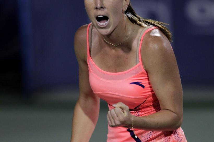 Jelena Jankovic of Serbia reacts after winning the first set against Andrea Petkovic of Germany during their semi-final round match of the 2011 Cincinnati Open tennis tournament in Cincinnati