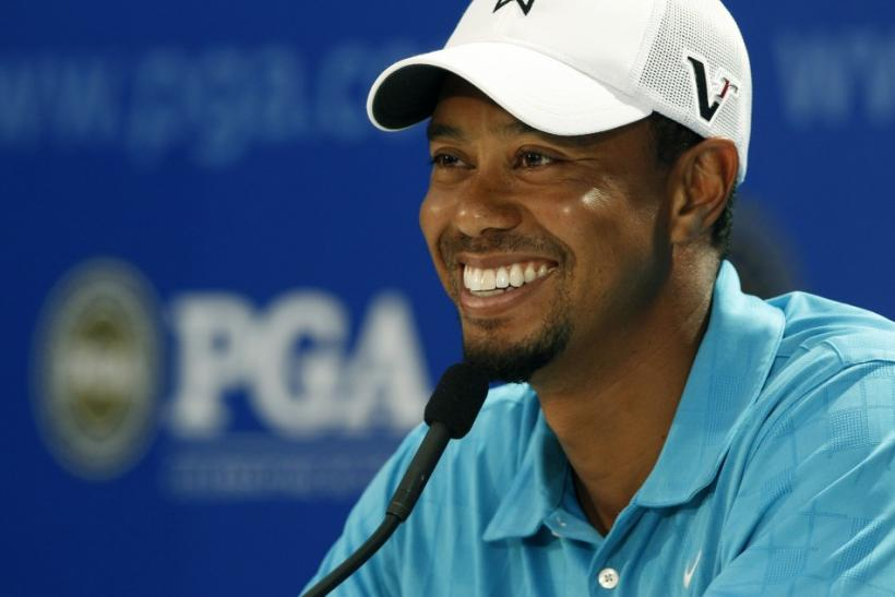 Tiger Woods of the U.S. talks to the media during his news conference following his final practice round before the start of the 93rd PGA Championship golf tournament at the Atlanta Athletic Club in Johns Creek, Georgia