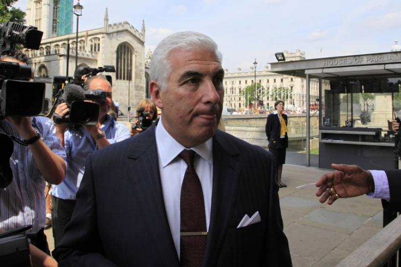 Mitch Winehouse, the father of deceased British singer Amy Winehouse, arrives at the Houses of Parliament in London