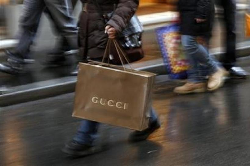 Shoppers stroll along Condotti street during the Christmas season in downtown Rome