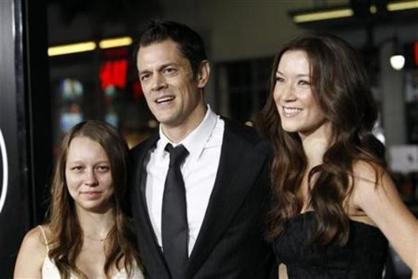 Cast member Johnny Knoxville with his wife Naomi Nelson (R) and daughter Madison pose at the premiere of ''Jackass 3D'' at Grauman's Chinese theatre in Hollywood, California