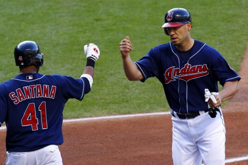 Cleveland Indians Hafner is greeted by Santana after scoring on an Toronto Blue Jays error during their MLB American League baseball game in Cleveland
