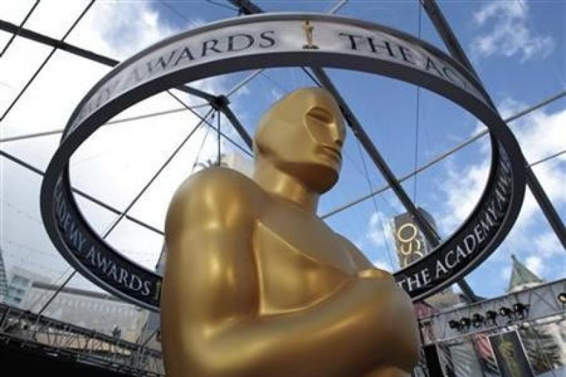 An Oscar statue is seen beneath plastic sheeting during preparations for the 83rd Academy Awards in Hollywood, California