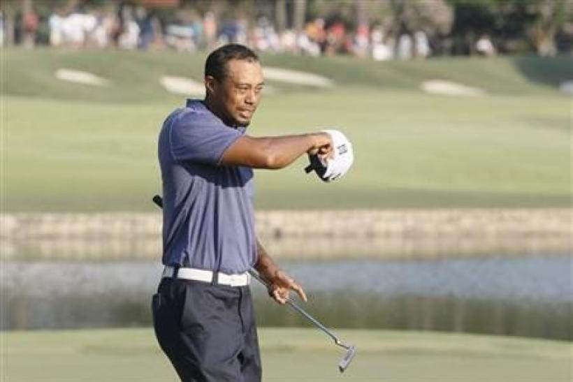 Tiger Woods of the U.S. takes off his hat after completing the 18th hole, finishing play in the second round of the 93rd PGA Championship golf tournament at the Atlanta Athletic Club in Johns Creek, Georgia