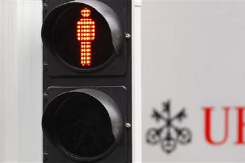 A traffic sign is seen next to an UBS logo in Zurich