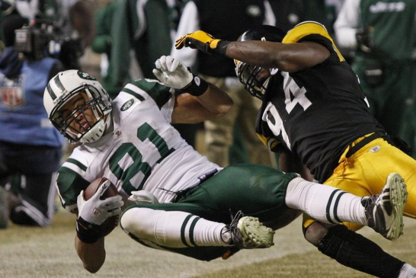 New York Jets tight end Keller is hit by Pittsburgh Steelers linebacker Timmons in the fourth quarter during the NFL AFC Championship football game in Pittsburgh