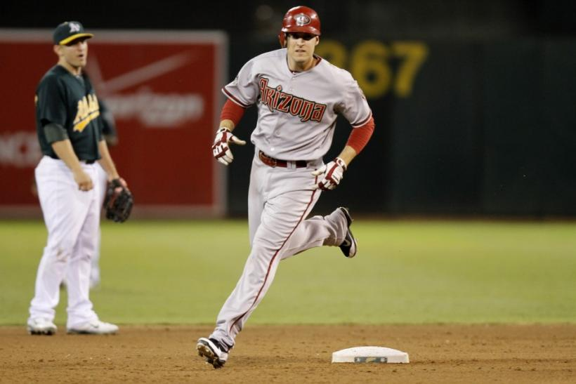 Diamondbacks Johnson rounds second base after hitting an eighth inning home run against Athletics during their MLB Interleague baseball game in Oakland