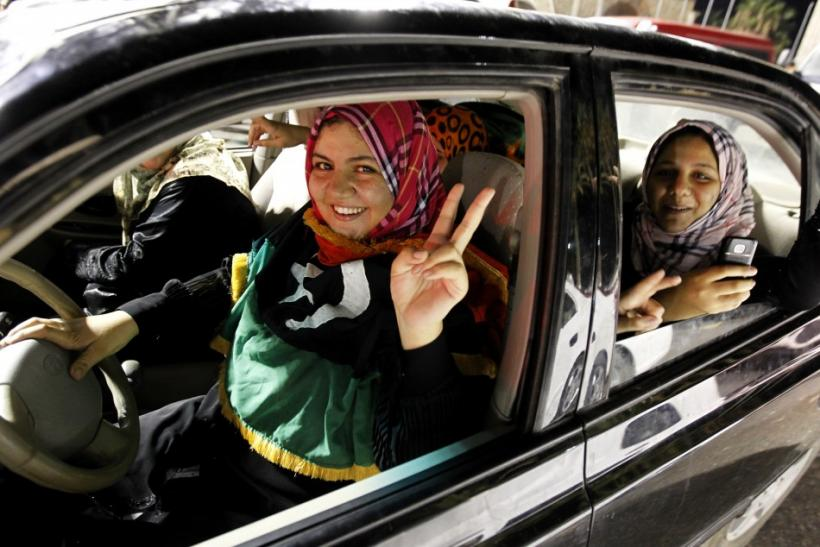 A woman flashes a victory sign during celebrations in Green Square, renamed Martyrs Square by rebels, in Tripoli