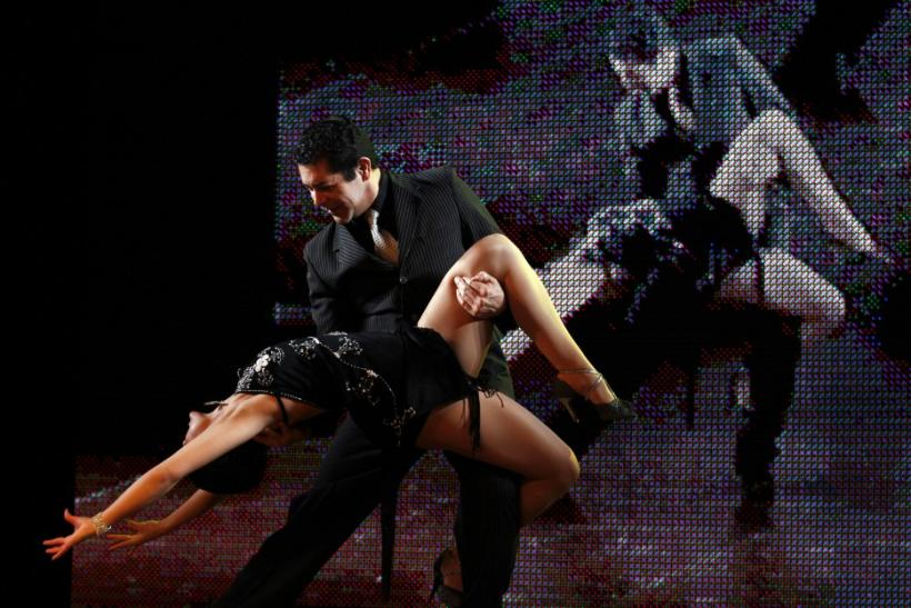 Jose Luis Medina (C) and Natalia Liendo of Argentina perform during the qualifying round stage of Argentina's eighth edition of the Tango Dance World Championship in Buenos Aires