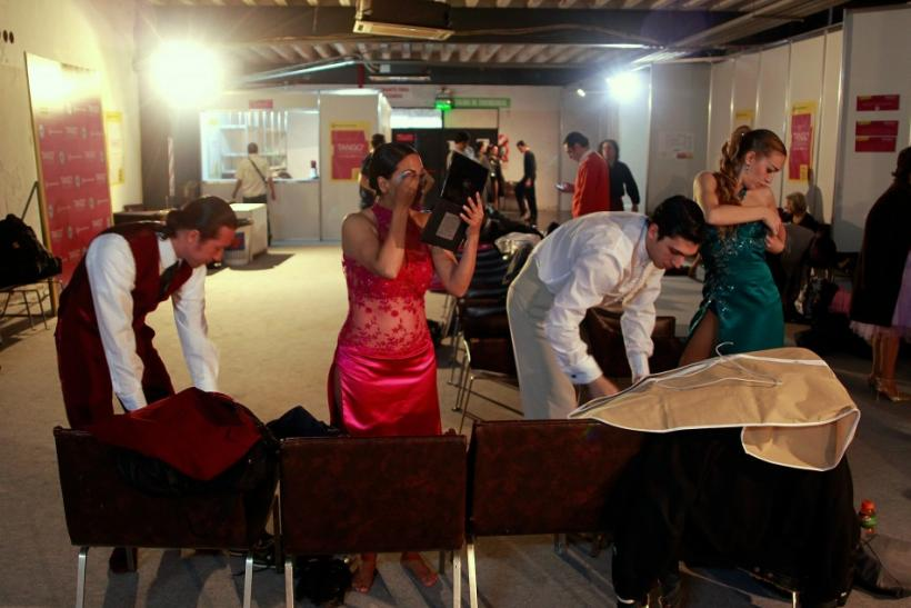 Dancers get ready backstage for the qualifying round stage of Argentina's eighth edition of the Tango Dance World Championship in Buenos Aires