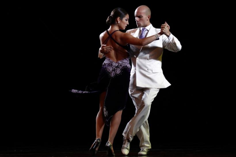 Andrea Degani (R) and Giovanna Di Fazi of Italy perform during the qualifying round stage of Argentina's eighth edition of the Tango Dance World Championship in Buenos Aires