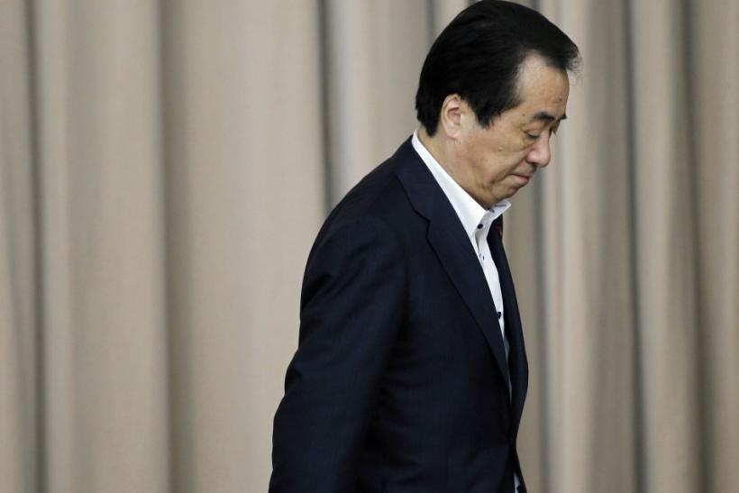 J apan's Prime Minister Naoto Kan leaves from the podium at a general meeting of his DPJ lawmakers in Tokyo