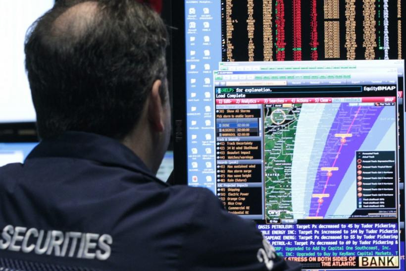 A trader looks at the path of Hurrican Irene on the floor of the New York Stock Exchange
