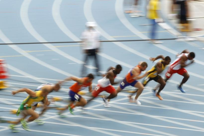 Competitors run during the 100 metres heat of the men's decathlon at the IAAF World Championships in Daegu