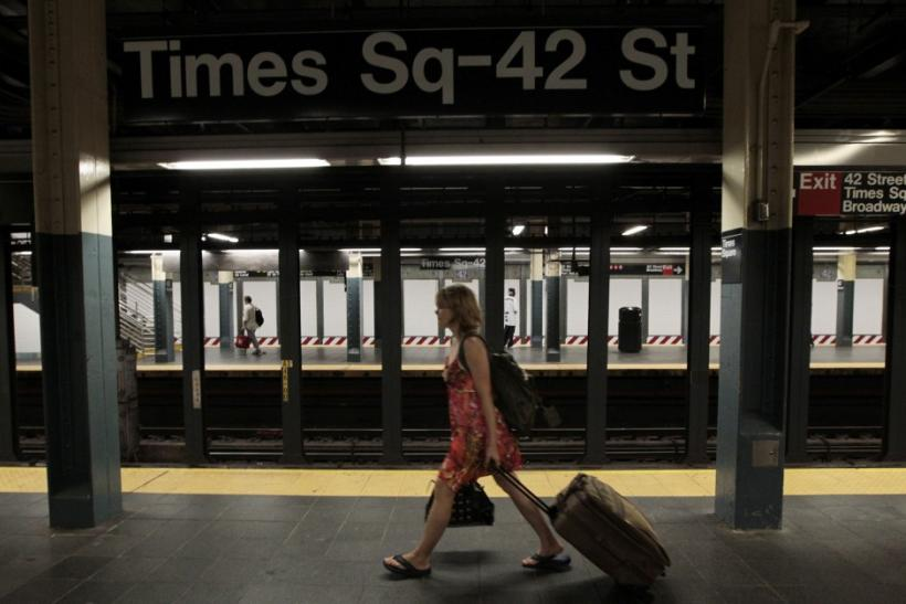 A woman walks through the Times Square subway station after the last subway has left