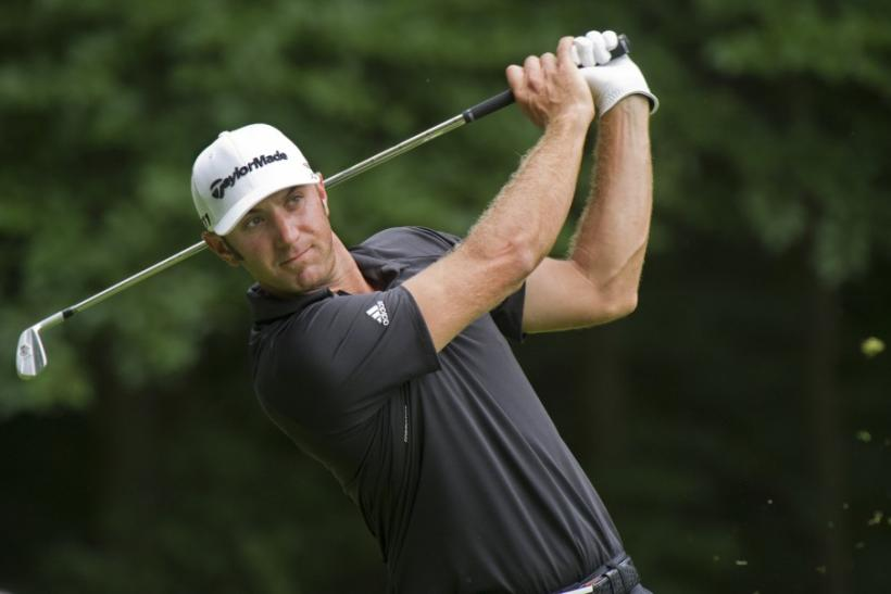 Dustin Johnson of the U.S. watches a tee shot at the 14th hole during the third and final round of the hurricane-shortened Barclays golf tournament in Edison