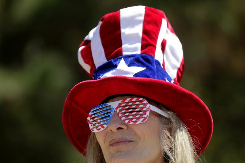 Karen Patterson listens to speakers during a Tea Party rally in Napa