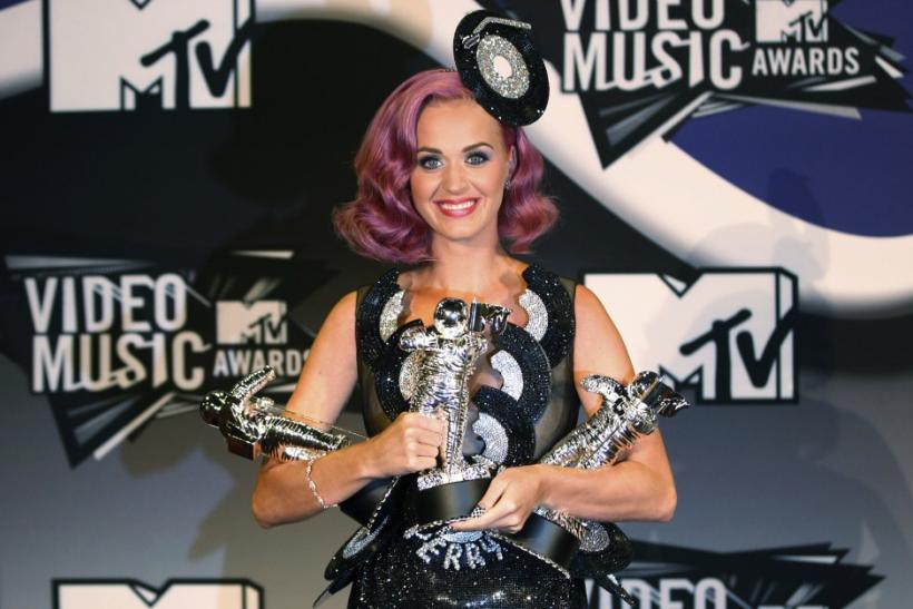"Singer Katy Perry poses with her three awards, Video of the Year for ""Firework"", Best Collaboration, and Best Special Effects which she won at the 2011 MTV Video Music Awards in Los Angeles"