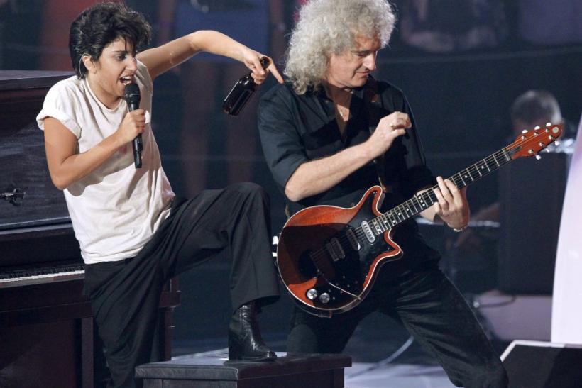 "Lady Gaga, dressed as a man, performs ""You and I"" with Brian May from Queen at the 2011 MTV Video Music Awards in Los Angeles"