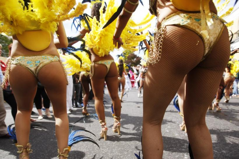 Performers dance in the street parade at the annual Notting Hill Carnival in central London