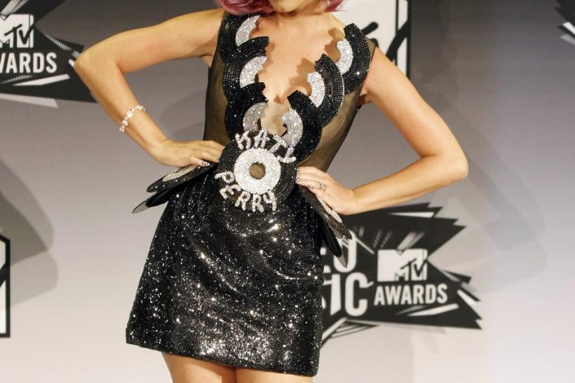 "Singer Katy Perry poses for photographers after winning video of the year for ""Firework"", Best Collaboration, and Best Special Effects at the 2011 MTV Video Music Awards in Los Angeles"