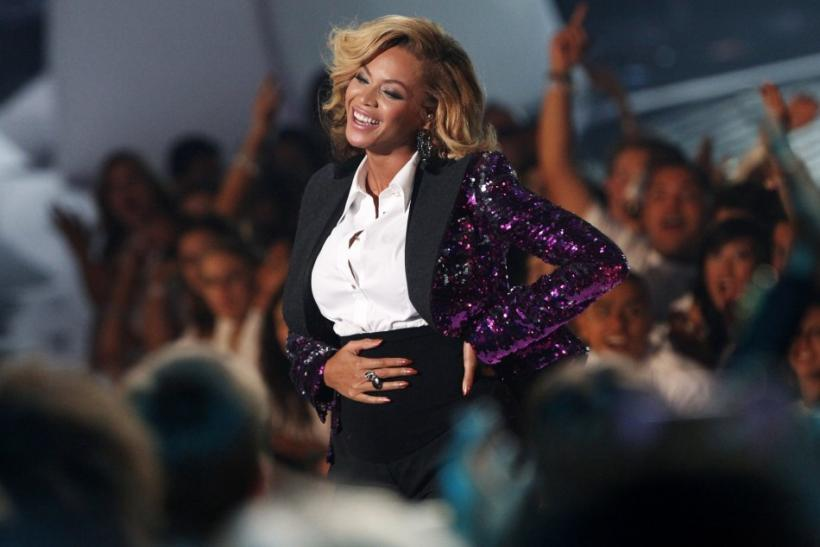 Beyonce rubs her stomach