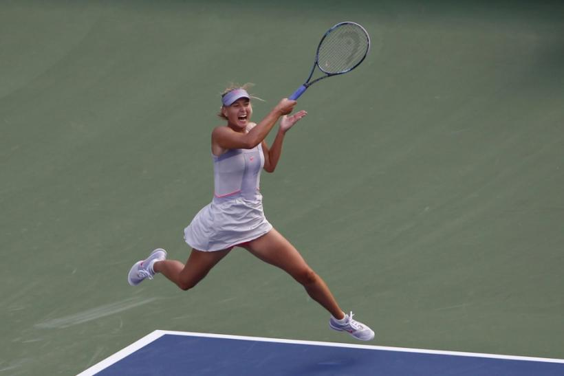 Maria Sharapova of Russia hits a return to Heather Watson of Britain during their match at the U.S. Open tennis tournament in New York