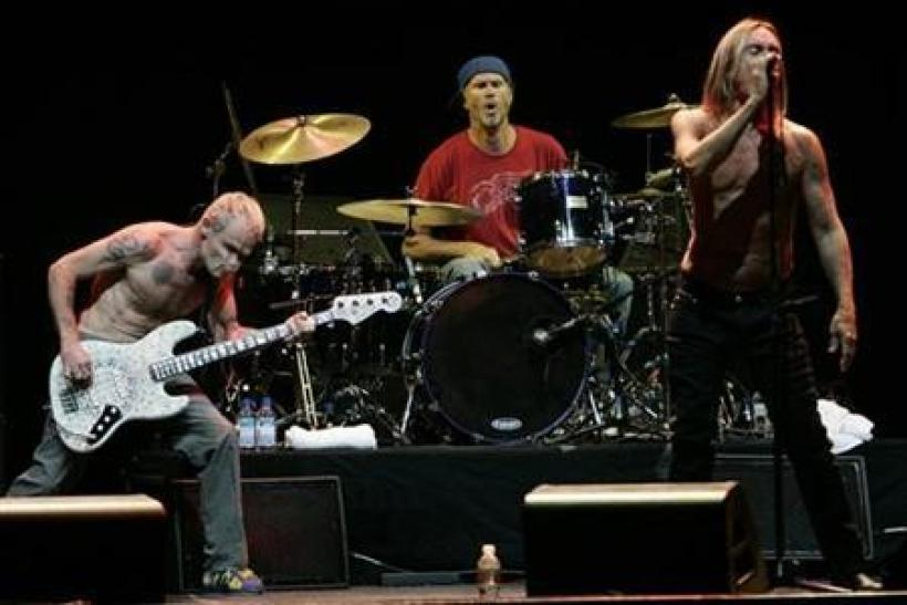 Flea (L) and drummer Chad Smith (C) of the Red Hot Chili Peppers (RHCP) and Iggy Pop perform at the Musicares MAP Fund benefit concert in Los Angeles