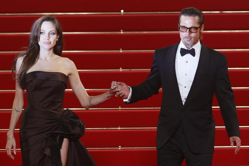 Cast member Pitt and actress Jolie leave the festival palace after the screening of the film The Tree of Life in competition at the 64th Cannes Film Festival