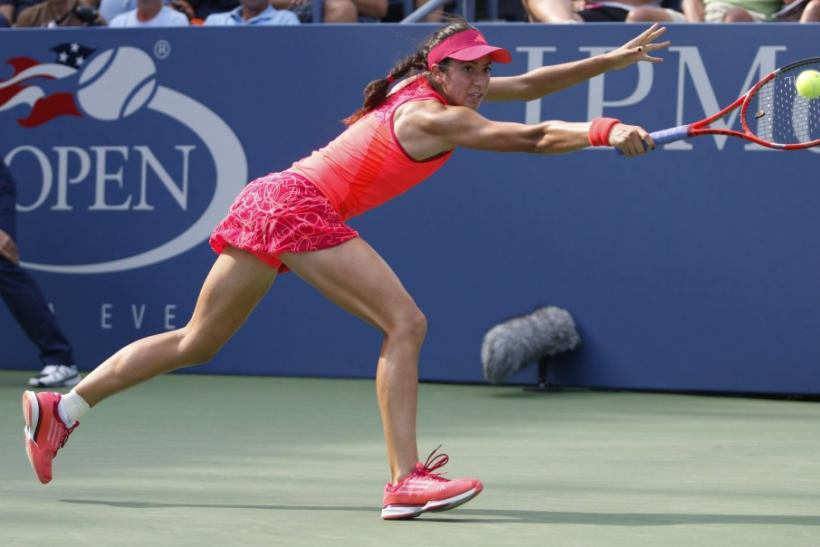 Christina McHale of the U.S. hits a return to Marion Bartoli of France during their match at the U.S. Open tennis tournament in New York