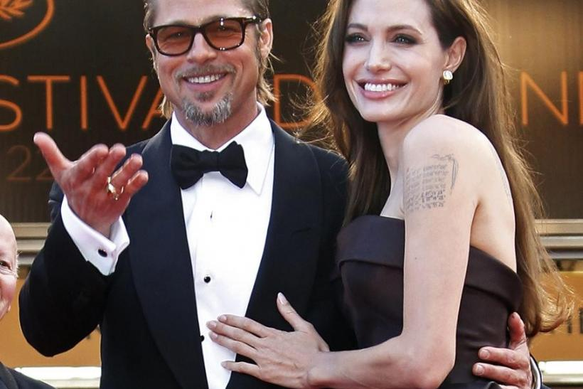"Cast member Pitt and actress Jolie arrive for the screening of the film ""The Tree of Life"" at the 64th Cannes Film Festival."