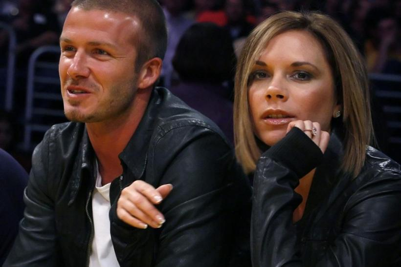 Los Angeles Galaxy Beckham sits with his wife as they watch the Los Angeles Lakers play the San Antonio Spurs during Game 2 in Los Angeles.