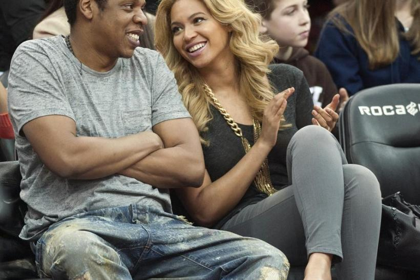 Jay Z and his wife Beyonce watch the New Jersey Nets play the Phoenix Suns in their NBA game in Newark.