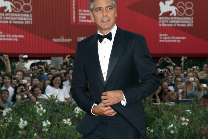 """U.S. actor Clooney arrives on the """"The Ides of March"""" red carpet at the 68th Venice Film Festival in Venice"""