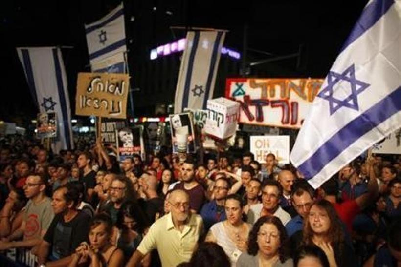 Demonstrators take part in a protest against the high cost of living and for social justice in Tel Aviv